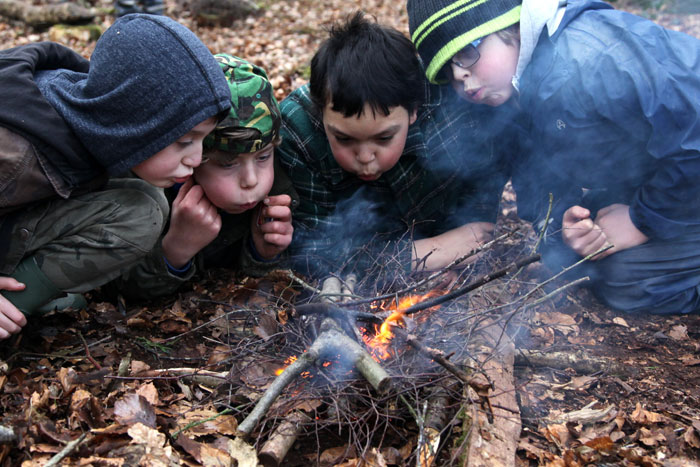 boys firelighting at forest school