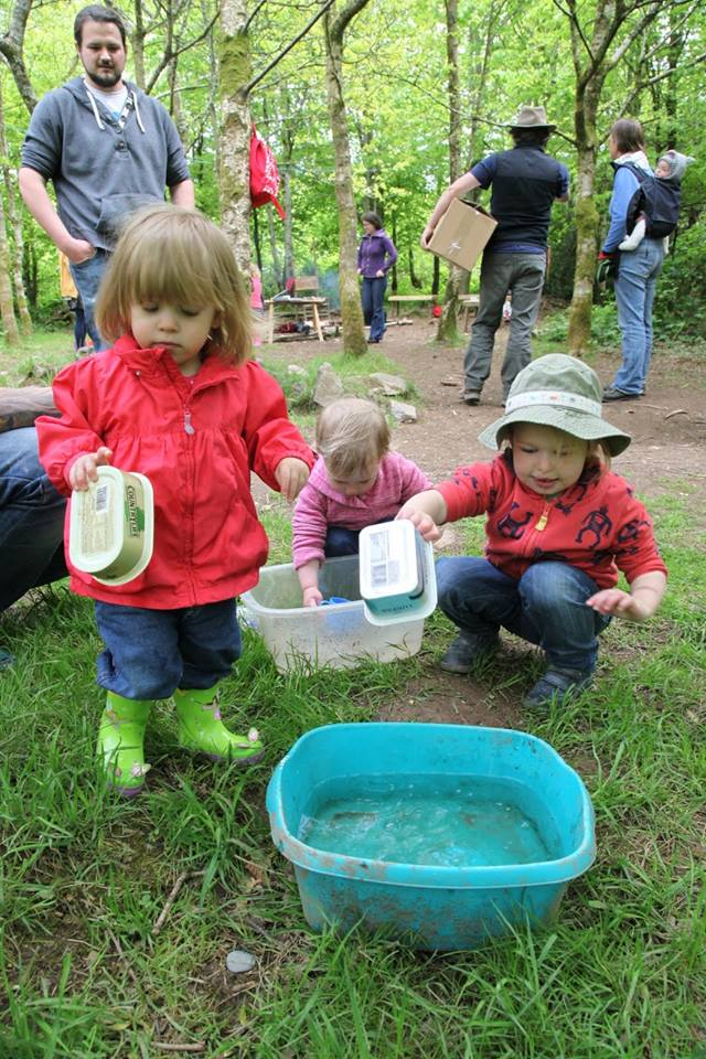 irls playing with water at forest school