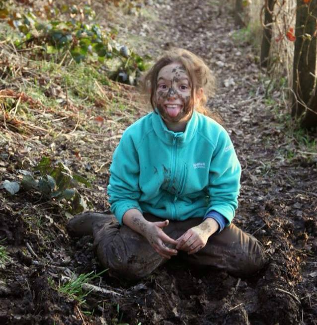 muddy girl outdoors