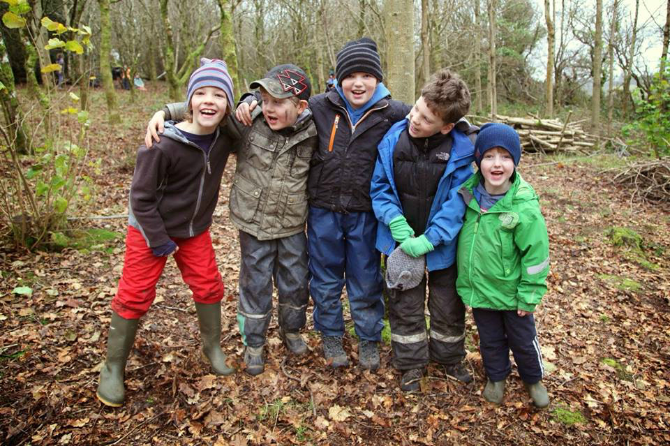 boys in forest school at winter