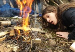 children learning firelighting skills