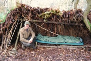 bushcraft leader with shelter