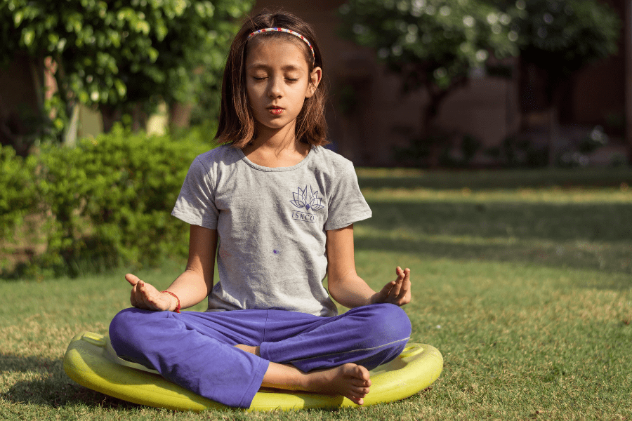 child meditating in the outdoors